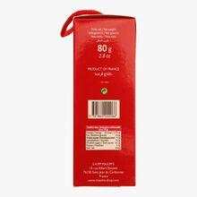 Box containing plain, pistachio and raspberry nougat. Maxim's