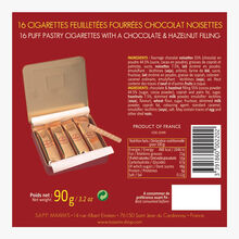 16 puff pastry cigarettes filled with hazelnut chocolate Maxim's