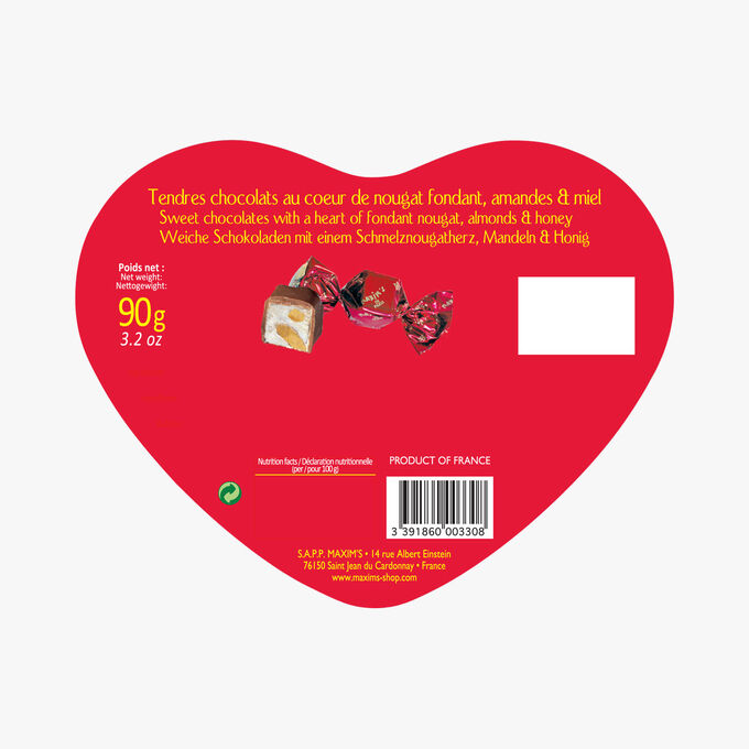 Red heart box of chocolates with soft nougat, almond and honey centres. Maxim's